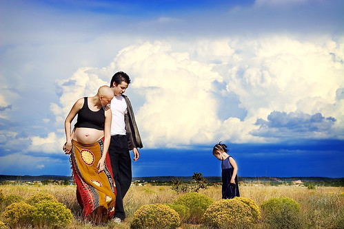 Sarah and her family framed by rainclouds | by Ana June