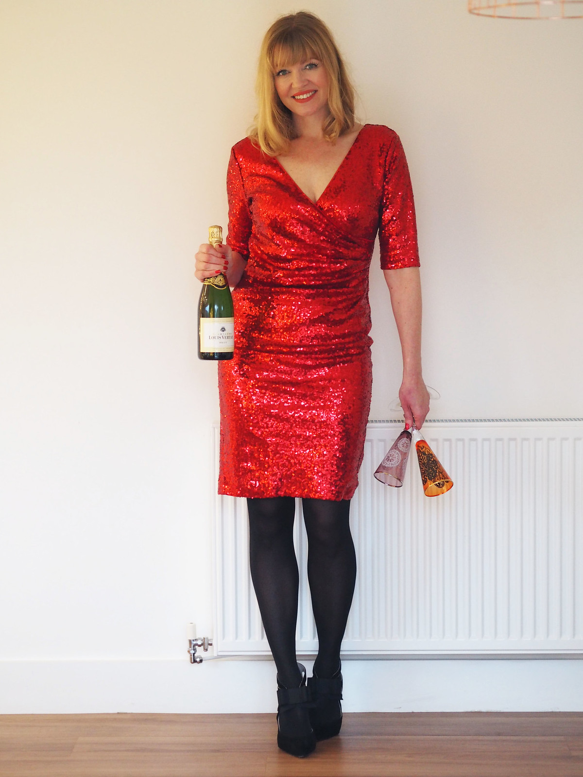 Liz of What Lizzy Loves  in a Christmas party outfit, over 40 style