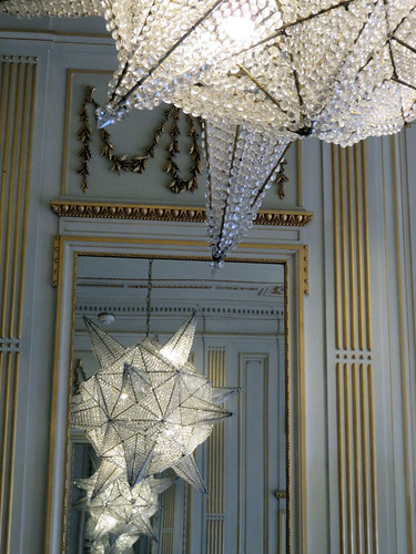 A reflection of endless star chandeliers in the Escher Museum in Den Haag, Holland