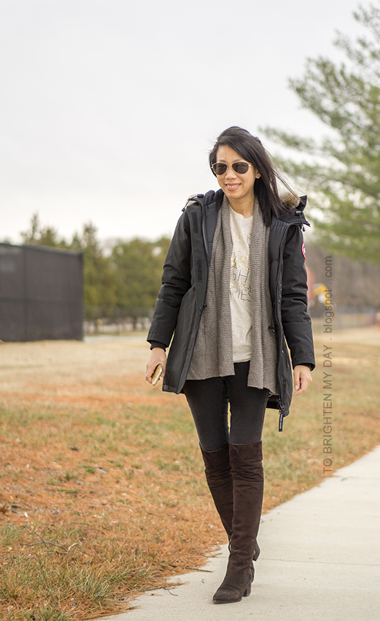 black parka, taupe open cardigan sweater, graphic tee, black skinny jeans, brown suede over the knee boots