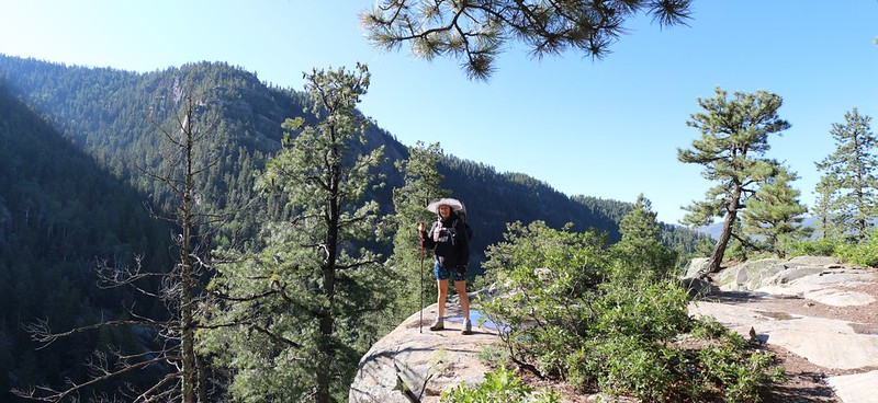 Vicki on a rock outcropping high above the creek on the Vallecito Creek Trail