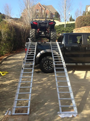 An Atv And Ramps Loaded On Top Of A Ford F150 Truck Bed