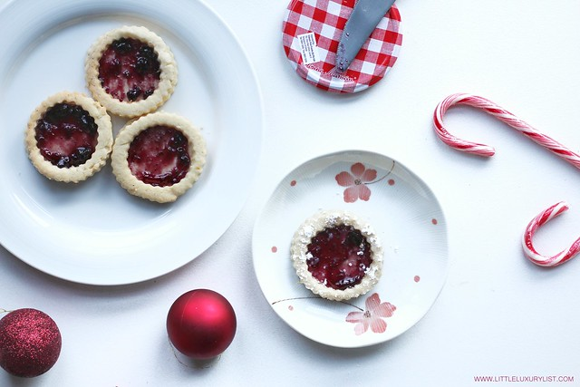 Gluten free sugar or Linzer cookies top view by little with holiday decor and candy canes luxury list.