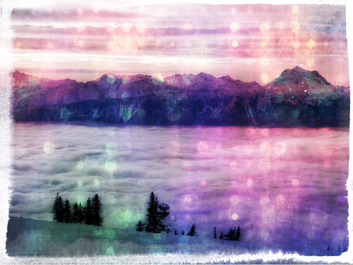 A river clouds runs through Revelstoke mountains (photo apped in Pixlromatic)
