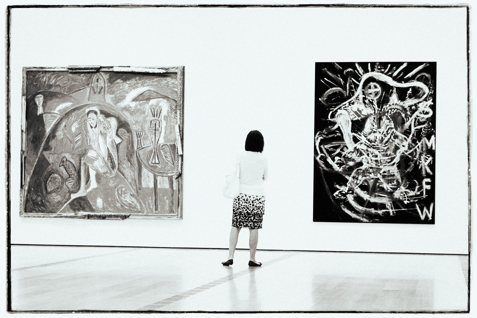 Woman in Black and White Skirt Viewing Art, High Museum, 2015