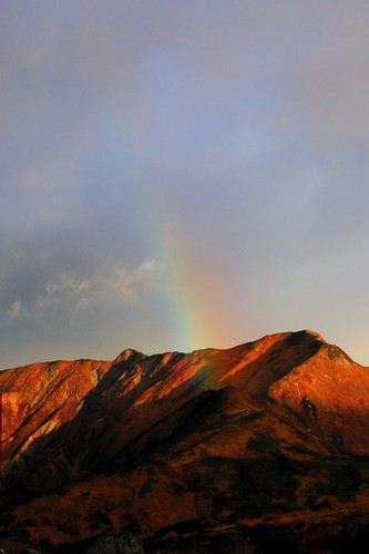red mountain and rainbow