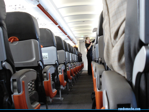 Empty seats on a plane | by Soon.