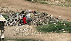 Red Child in the Rubbish