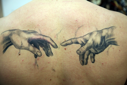 Grey hands tattoo for World in hands tattoo