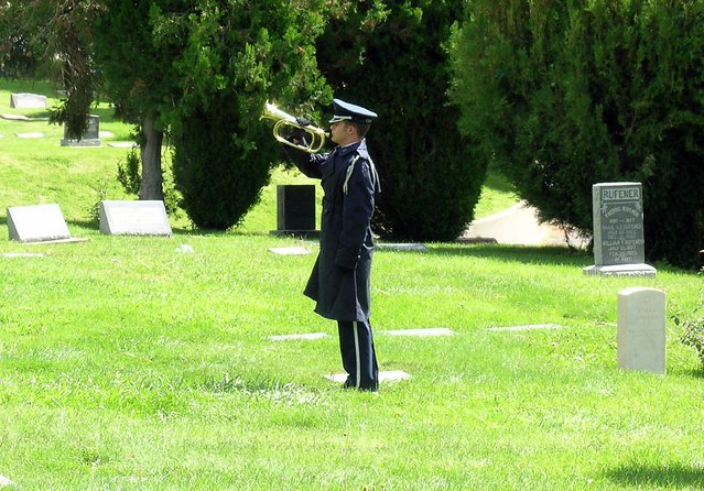 playing taps at a funeral