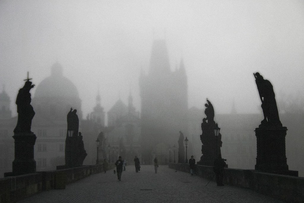 charles bridge at sunrise in the fog check out viator