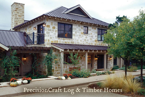 Custom design of a timber frame and log home hybrid prec for Stone and timber homes