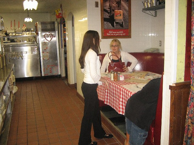 Susan Settling In The Kitchen Booth At Buca Di Beppo Ita Flickr