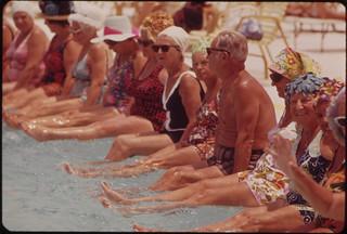 resid,of,centuri,villag,retir,communiti,gather,around,pool,for,daili,exercis,session