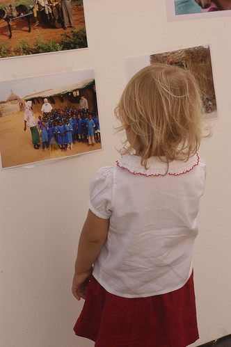 a little one looks at the Darfur photographs | by shauna | glutenfreegirl