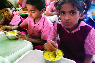 Indian kids eating | by Bread for the World