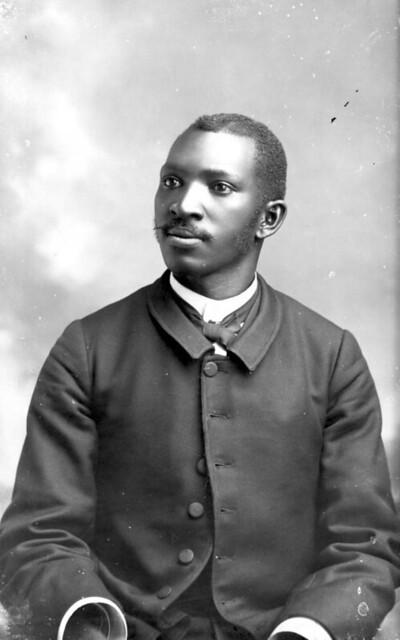 Black Man With Sideburns Wearing Dark Coat Portraits Of