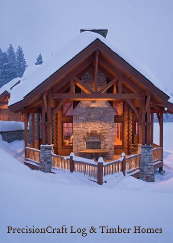 Snow Covered Exterior Of A Timber Frame Log Home Hybrid