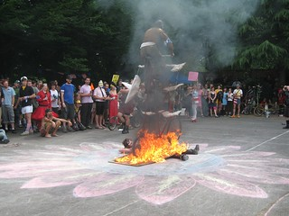 Guy on tall bike, jumping off ramp on fire that is supported by a clown. NICE. | by lmangano