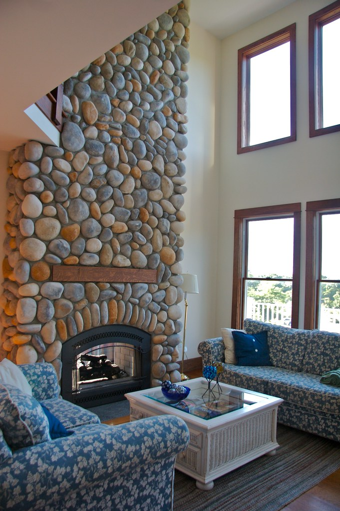 Cathedral Ceiling Living Room With Beach Stone Fireplace