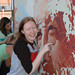 Student participating in painting of Cesar Chavez