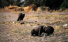 Sudan Vulture Behind Child | by e-strategyblog.com