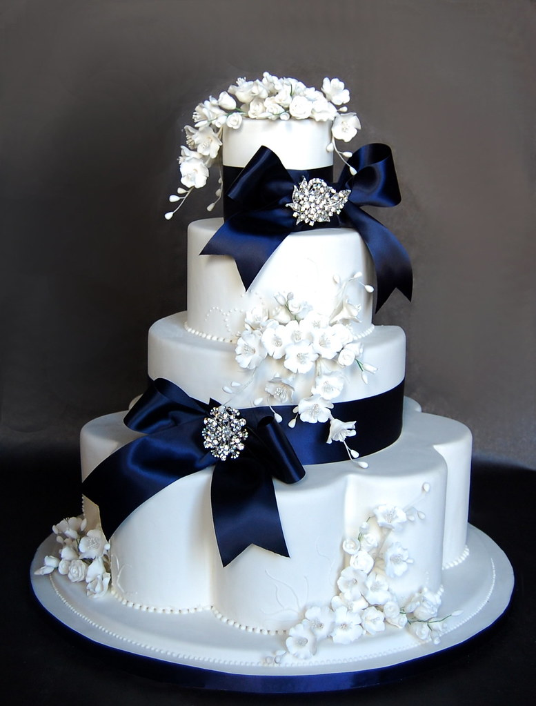 wedding cake with bows and bling blue bows and bling wedding cake cakes confidential 26837