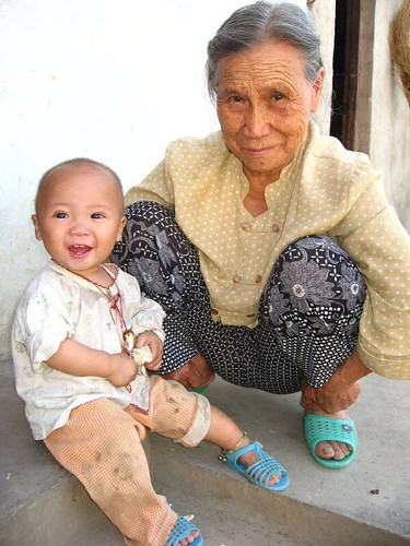 Old woman with young boy in a small village   Vueltaa   Flickr