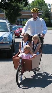 Three children in a bakfiets cargo bike | by Mark Stosberg