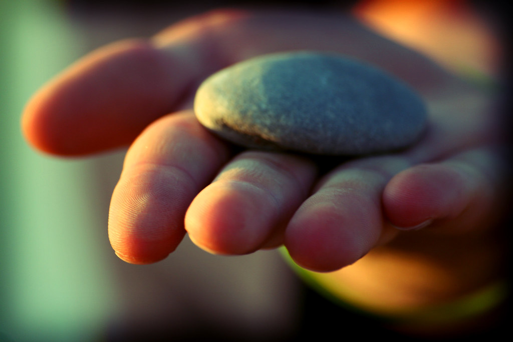 Hand Throwing Stone : Rock in hand strength and solidarity quot juju t brothers