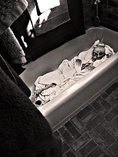 skeleton wrapped in a blanket in the tub+black and white | by ...love Maegan