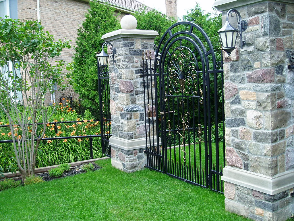 Stone Pillars And Iron Fence Front Yard Landscaping