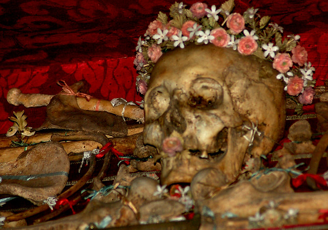 Skull Relic Adorned With A Crown Of Flowers In The Small