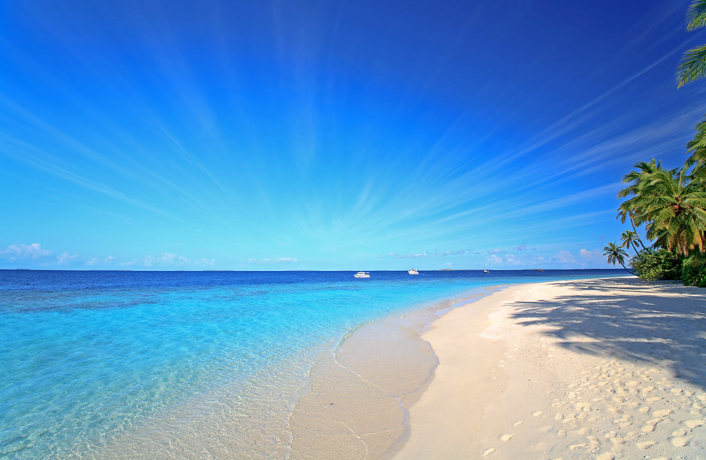 Deep Blue Sky Turquise Ocean And Sandy Beach Maria