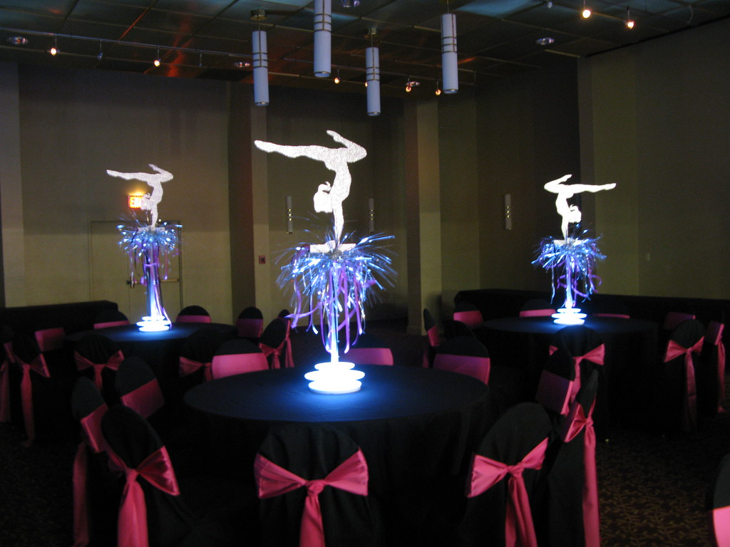 Custom gymnastic themed centerpieces with led light bases