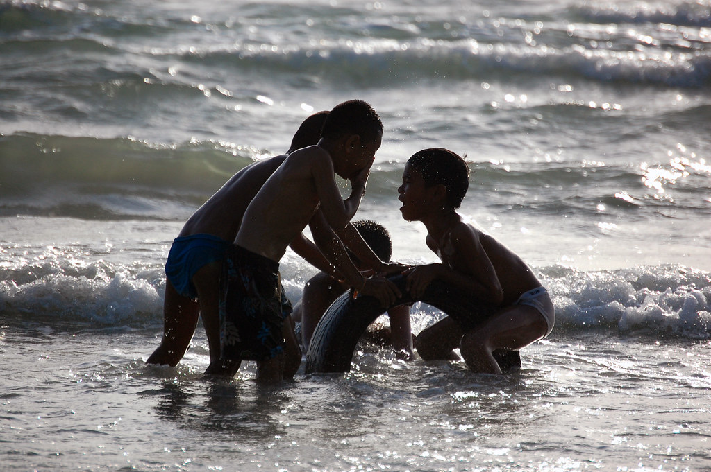 Kids Playing In A Beach In Phuket Thailand View On