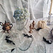 vintage crystal dishes+tarnished silver platters and tea set+blue hydrangeas+ghost table+halloween tabletop decorating ideas