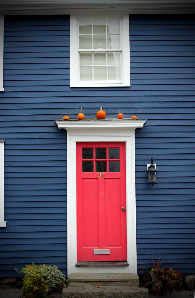 Red Door These Little Orange Pumpkins Above The Red Door