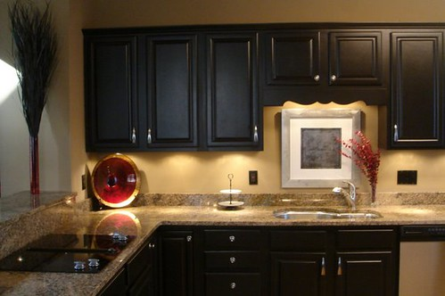 Dark Wood Kitchen Cabinets Black Appliances Mixed Tile Backsplash