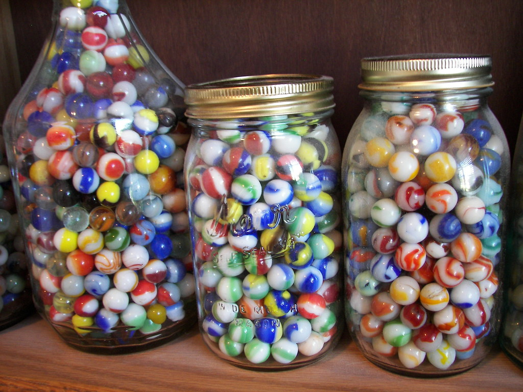 Three Jars Of Marbles On A Shelf Some More Of My