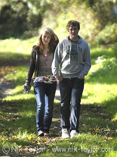 Teen Couple Walking Through The Woods  Copyright Nik -2391