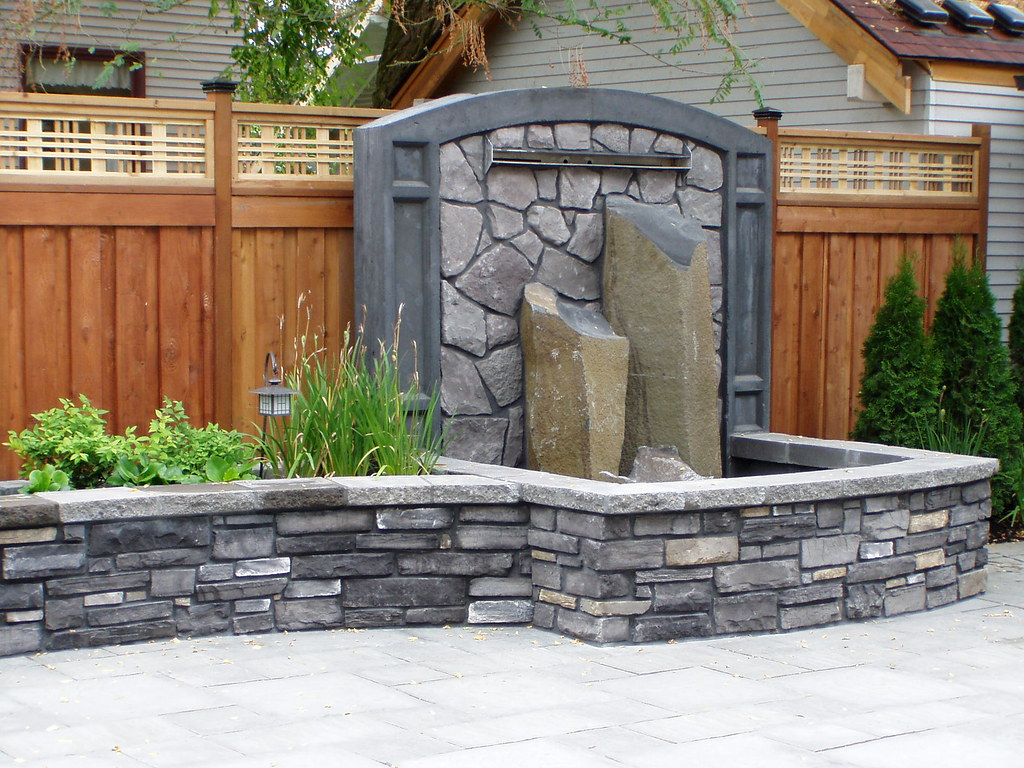 Stone Veneer Planter With Water Fall (Baker Masonry LLC 50