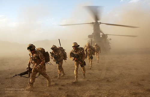 Soldiers from 3 Scots Deploy from a Chinook Helicopter in Afghanistan | by Defence Images