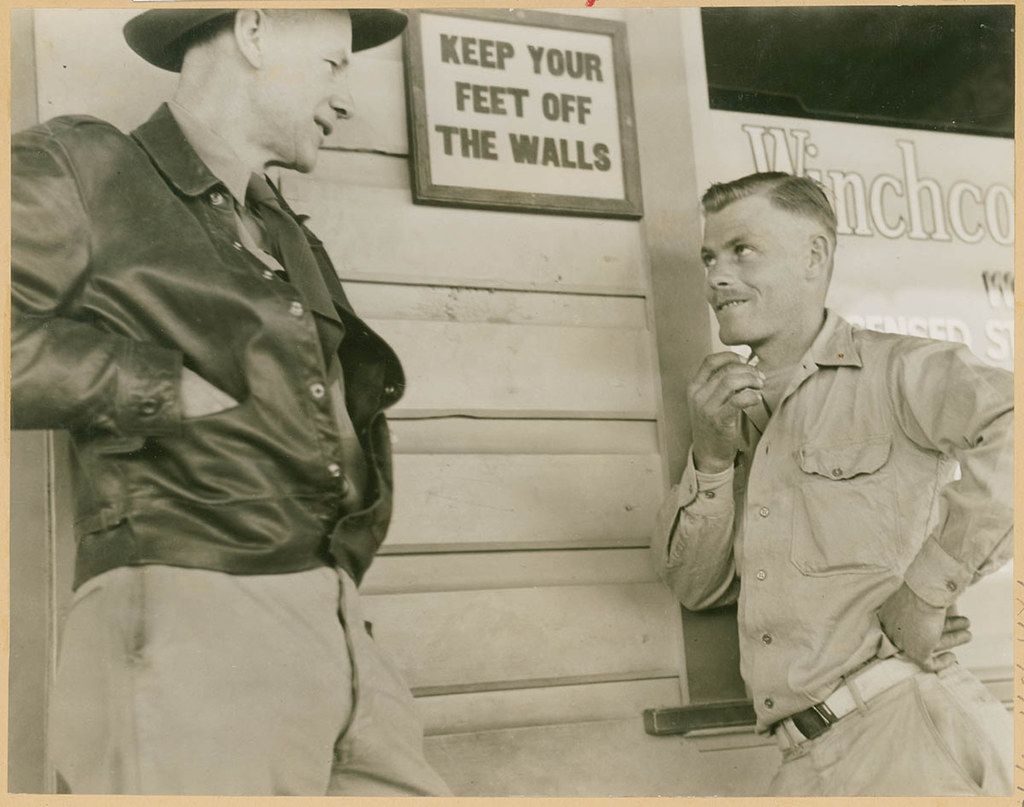 Two Men Talk Next To Sign Keep Your Feet Off The Walls Flickr