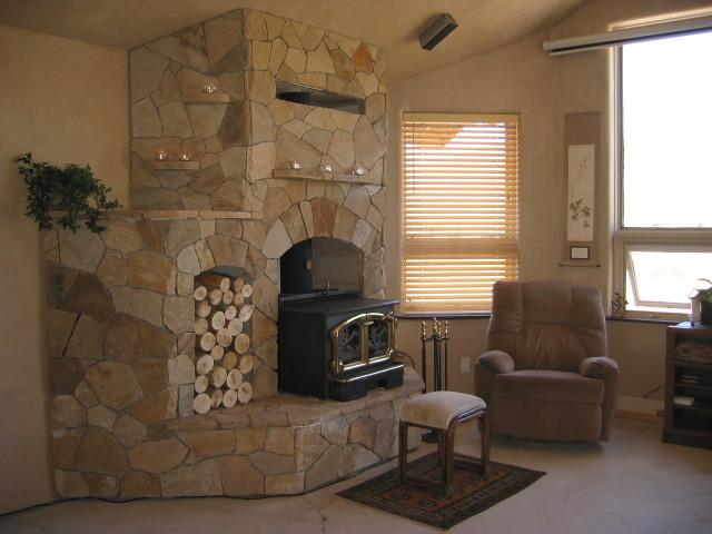 Stone fireplace w/wood stove | A stone veneered fireplace ...