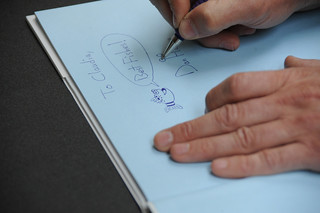 Illustrator, Dan Hanna, autographs a  book during the 4th Annual Children's Reading Celebration and Young Authors' Fair | by California State University Channel Islands