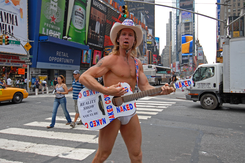 Naked Cowboy playing guitar on Times Square, New York