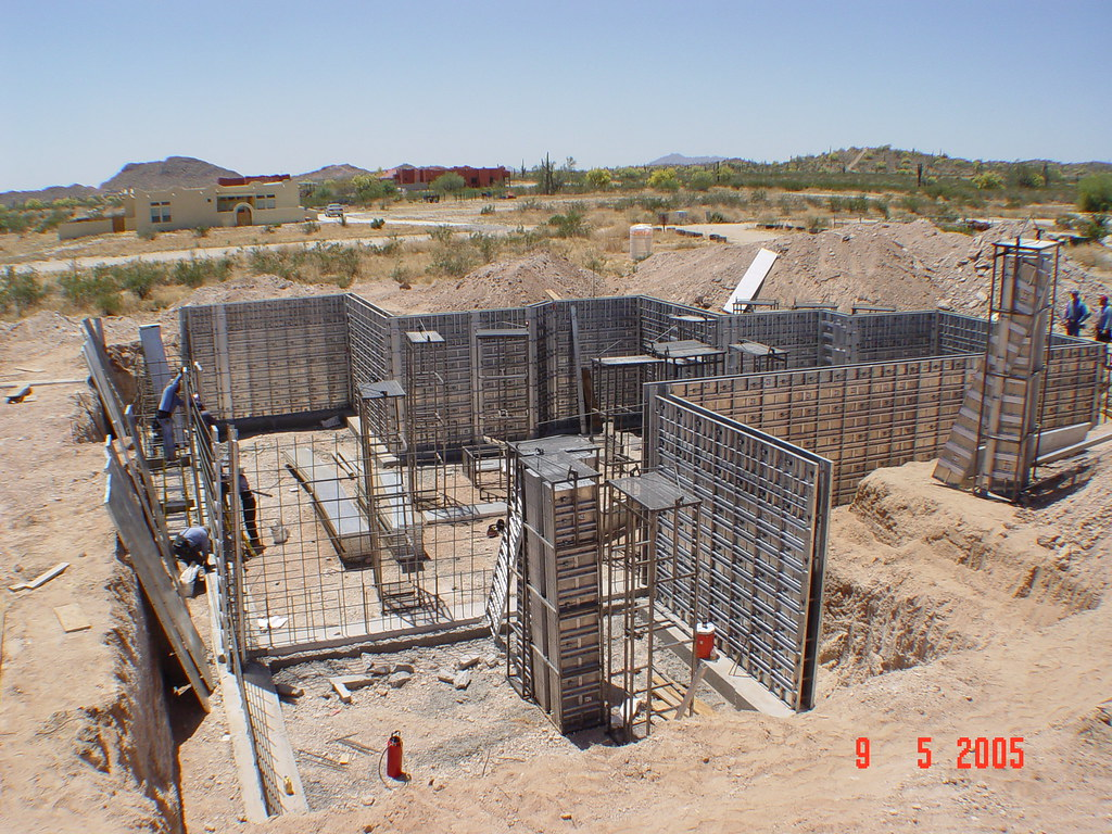 Aluminum forms concrete forms being set to pour a for Basement forms