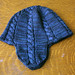 Stormy cabled earflap hat