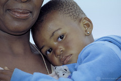 Close-up of child in mother's arms. Botswana | by World Bank Photo Collection